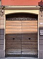 Door with shell-shaped doorknobs in Reggio Emilia, Italy 01.jpg