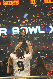 Brees celebrating the Super Bowl win with his son ece345dab