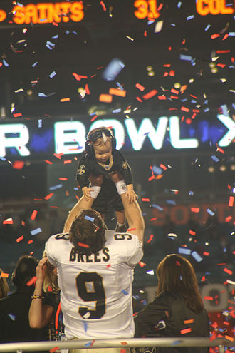Drew Brees - Brees celebrating the Super Bowl win with his son, Baylen