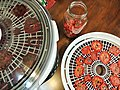 Dried tomatoes, dehyrdator and conditioning jar.jpg