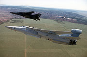 EF-111A and F-111F in flight