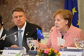 Klaus Iohannis - Iohannis with German Chancellor Angela Merkel in March 2018