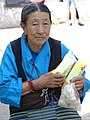 Elderly Woman in Street - McLeod Ganj - Himachal Pradesh - India (26162712363).jpg