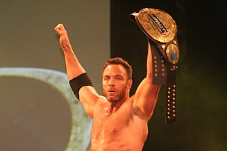 "Impact World Championship - Eli Drake with the fourth title belt design; note the ""Impact"" plate added to the title belt to reflect the company reverting to the Impact Wrestling name"