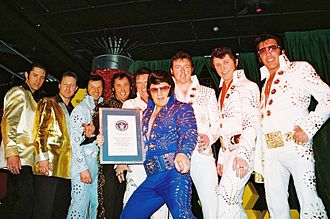 Elvis impersonator - Members of The Association of Professional Elvis Presley Tribute Artists setting the world record for the most Elvis impersonators in one location, in 2005
