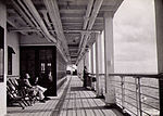 Enjoying the promenade deck of RMS Strathnaver, 1934.jpg