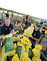 FEMA - 36608 - St. Charles city employees load sand bags into a truck in Missouri.jpg