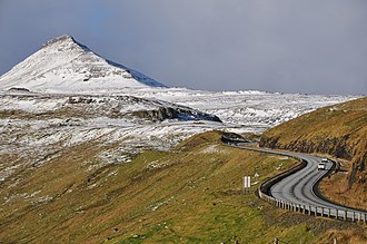 The road network on the Faroe Islands is highly developed. Shown here is the road from Skipanes to Sydrugota on the island of Eysturoy. Faroe Islands, Eysturoy, road from Skipanes to Sydrugota.jpg