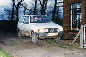 Road rally - Airborne Fiat Uno on the 1992 Noreaster road rally, Cambridgeshire, England