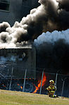 Firefighters work to put out the flames moments after a hijacked jetliner crashed into the Pentagon at approximately 0930 on September 11, 2001 010911-M-CI426-033.jpg