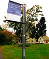 Fisherville sign with Main Street home in the background.jpg