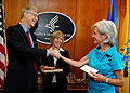 Francis Collins with Kathleen Sebelius after swearing-in ceremony.jpg