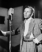 Sinatra behind a microphone