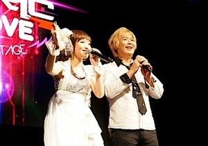 Yoshino Nanjō - Nanjō (left) appearing as the vocalist of fripSide at Anime Festival Asia 2012