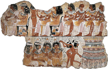A fragment of the frescoes on the wall of the tomb chapel of Nebamun, depicting guests, servants, musicians, and dancers at a funerary banquet