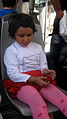 Girl sited on bus chair - Nishapur.JPG