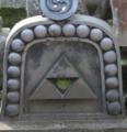 Grave with Hōjō emblem in Kamakura focus.png