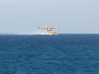 Canadair CL-415 - Two Hellenic Air Force CL-415 refilling their water tanks off the coast of Atlit, while in operation fighting the 2010 Mount Carmel forest fire