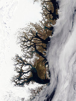 The coastline of eastern Greenland, with its many fjords. At the bottom is the longest fjord in the world, Scoresby Sund.