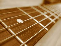 Guitar fretboard closeup