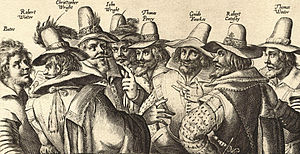 A monochrome engraving of eight men, in 17th-century dress; all have beards, and appear to be engaged in discussion.