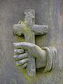 Hand and cross (2587685795).jpg