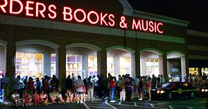 Potter fans wait in lines outside a Borders bo...