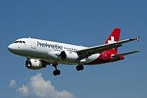 Helvetic Airways A319 HBJVK short final LSZB RWY 32.jpg
