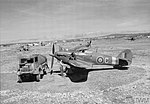 Hurricane Mark IV, KZ188 ?C?, of No. 6 Squadron RAF being refuelled, amid other aircraft of the Squadron, on a dispersal at Prkos,.jpg