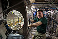 ISS-42 Terry Virts on the Microgravity Science Glovebox in the Destiny lab.jpg