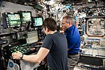 ISS-59 Anne McClain and David Saint-Jacques train inside the Destiny lab (2).jpg