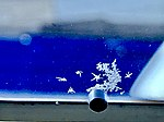Ice crystals on aircraft cabin window (October 2019).jpg