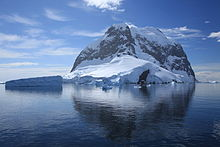 Icebergs and Booth Island, Antarctica (6062693592).jpg