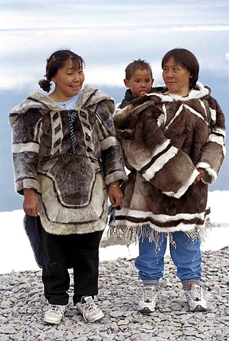 Igloolik - Traditional amautiit made from seal (left) and caribou (right) are occasionally worn by infants and mothers, although fabric versions are more common today