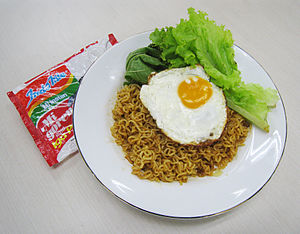 Fried egg - Mi Goreng noodle served with fried egg and vegetables.