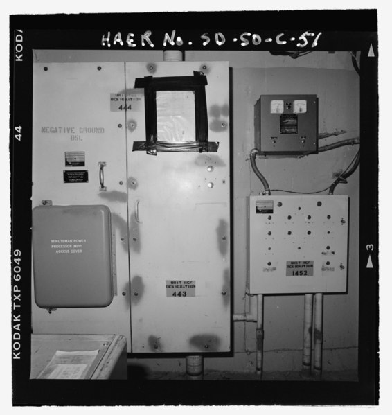 File:Interior of launch support building, minuteman power processor at lower left, power distribution panel at center, old diesel control panel at lower right, diesel battery at upper right HAER SD-50-C-51.tif