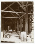 Interior work - barrels, wheelbarrows and a cart beneath wooden scaffolding (NYPL b11524053-489655).tiff