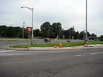 New York State Route 110 - NY 110 as seen from Old Country Road in Melville. The Northern State Parkway is visible crossing over NY 110 in the distance