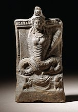 Statue of a snake with the upper torso and head of a woman