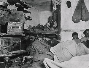 Slum - Inside of a slum house, from Jacob Riis photo collection of New York City (ca 1890).