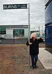 Jean Burns next to Burns Street sign.jpg