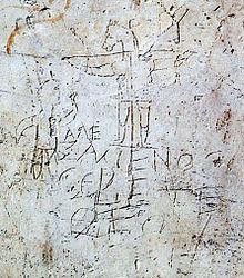 Il cosiddetto graffito di Alessameno, al museo sul colle Palatino a Roma, graffito pagano del secondo secolo che ritrae un uomo che adora un asino crocifisso, presumibile presa in gioco di un soldato cristiano. L'iscrizione riporta ?????????? (?????????C) ?????? (CEBETE) ????, che si traduce