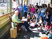 Lithgow reading a book to children