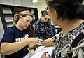 Julie Porucznik, left, a volunteer with Project HOPE, helps schedule patients to board Military Sealift Command hospital ship USNS Mercy (T-AH 19) during a surgical civic action project aboard hospital ship USNS 120606-O-ZZ999-001.jpg
