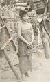 KITLV - 80265 - Kleingrothe, C.J. - Medan - Batak woman with water kettles, probably in the east coast of Sumatra - 1898.tif