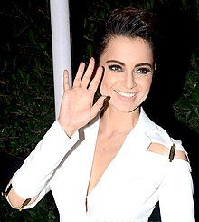 Kangana Ranaut waves and smiles at the camera