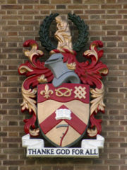 The University's Arms, as displayed on the front of the Library