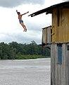 Kid jumping in river Maracanã 2.jpg