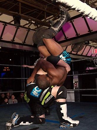 Backbreaker - Joey Kings does a tilt-a-whirl backbreaker on Justin Sane.