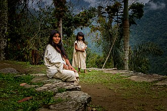 Kogi people - A portrait of a Koguis Tribeswoman and child on one of the terraces at Ciudad Perdida, Colombia.